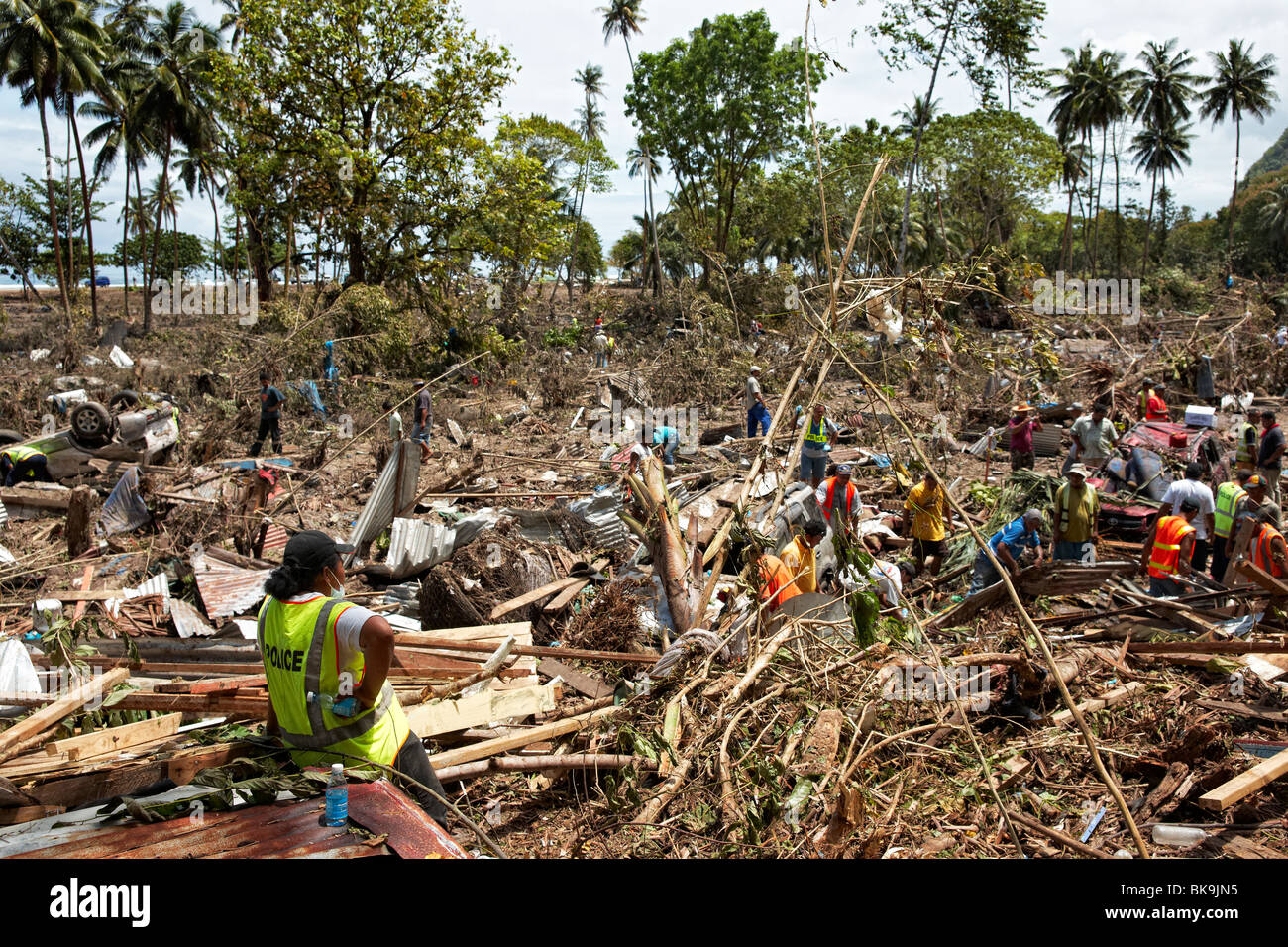 Searching for survivors after 2009 tsunami, Samoa - Stock Image