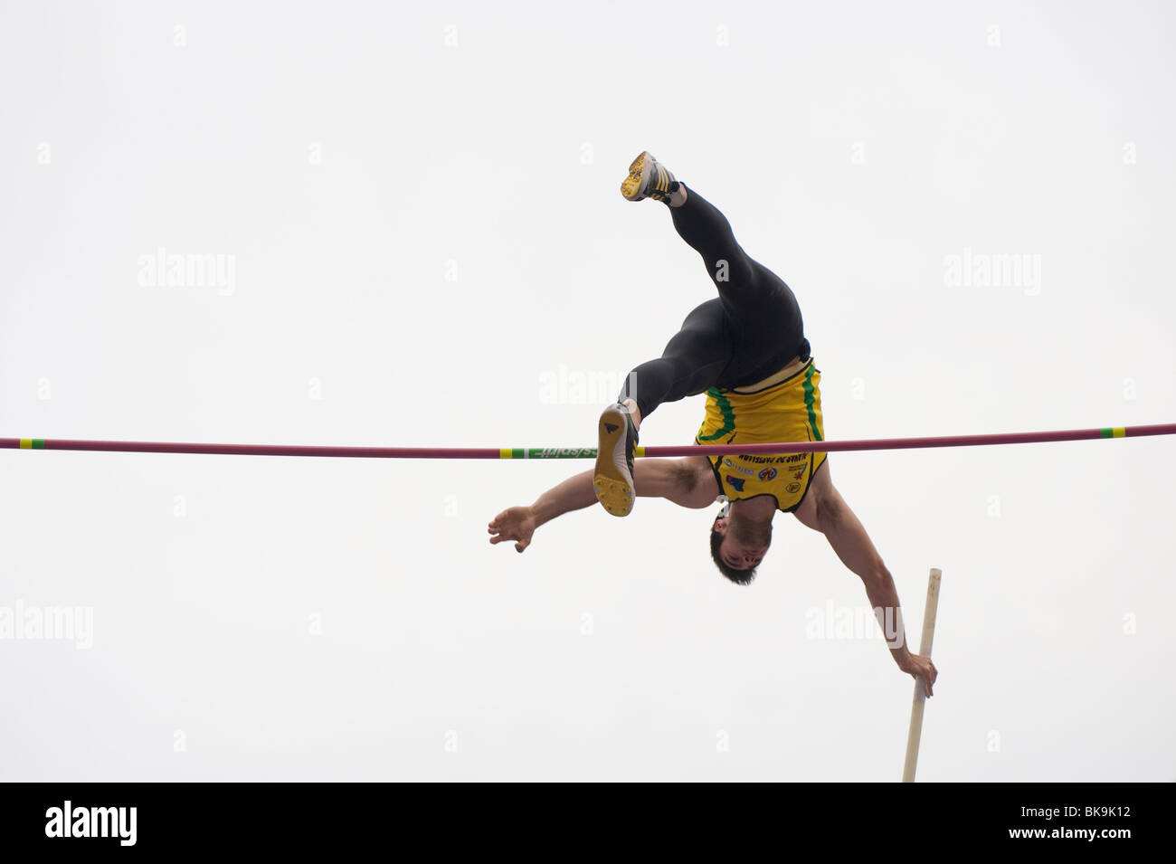 Pole Vaulter attempting to clear the bar, Arc de triomf Competition, Barcelona, Spain. - Stock Image