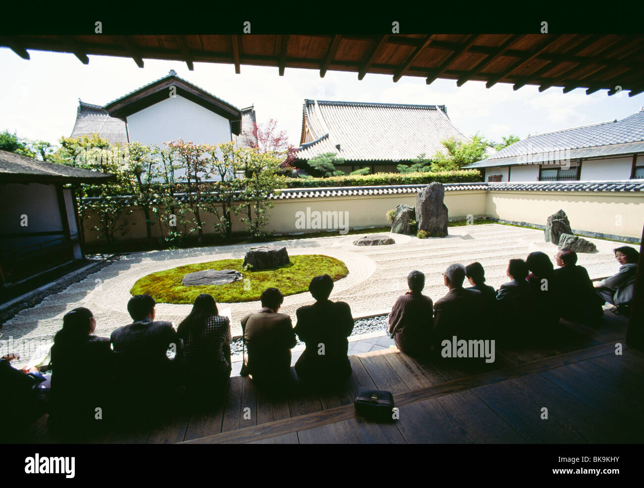 Tourists in a temple, Isshidan Rock Garden, Ryogen-In, Daitokuji Temple, Kyoto City, Kyoto Prefecture, Japan - Stock Image