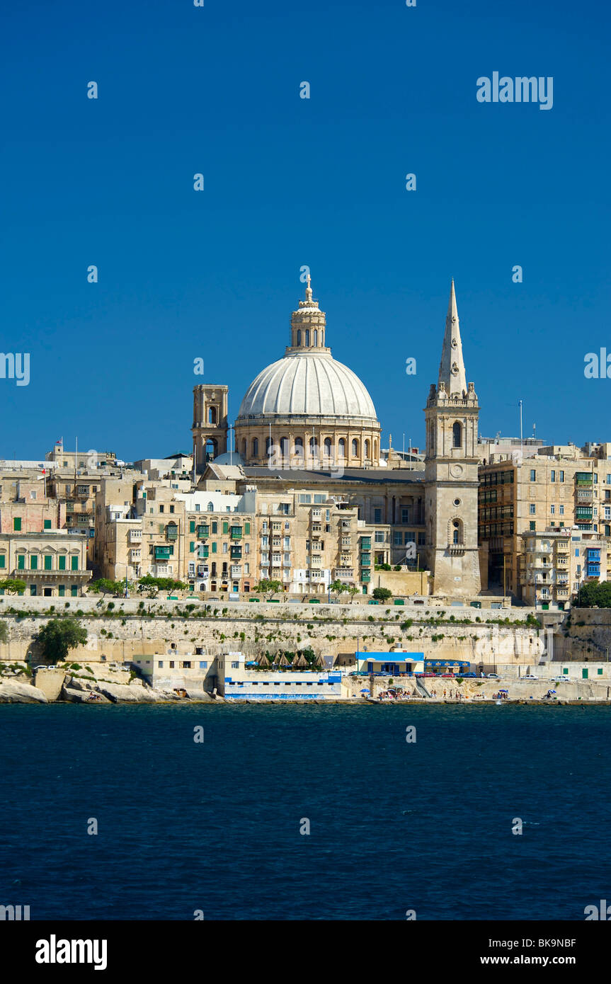 View from Sliema on the Cathedral of Valletta, Malta, Europe - Stock Image