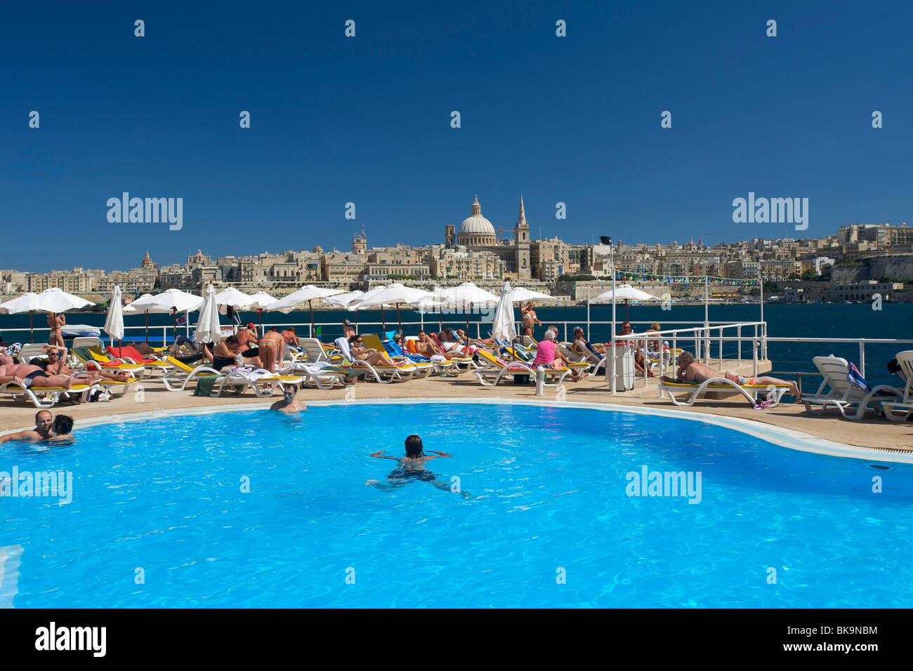 View from a hotel pool in Sliema to Valletta, Malta, Europe - Stock Image
