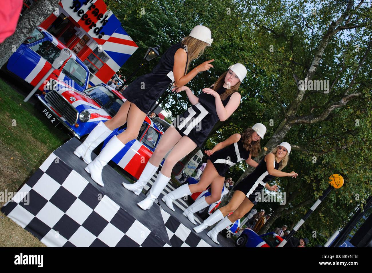 Mini dresses and mini cars at Goodwood Revival - Stock Image