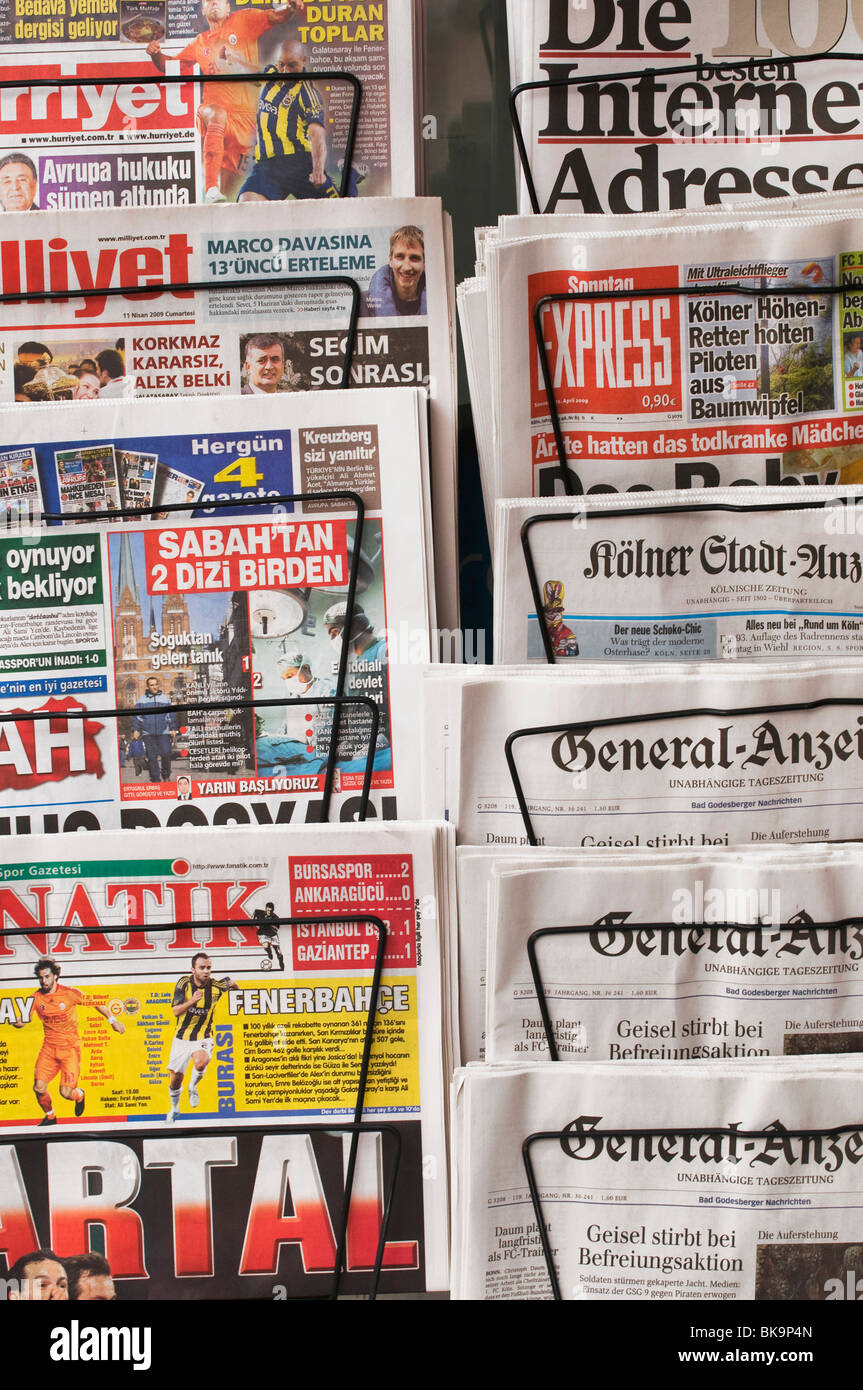 News rack with German and Turkish daily newspapers, some Sunday papers, some weekend editions - Stock Image