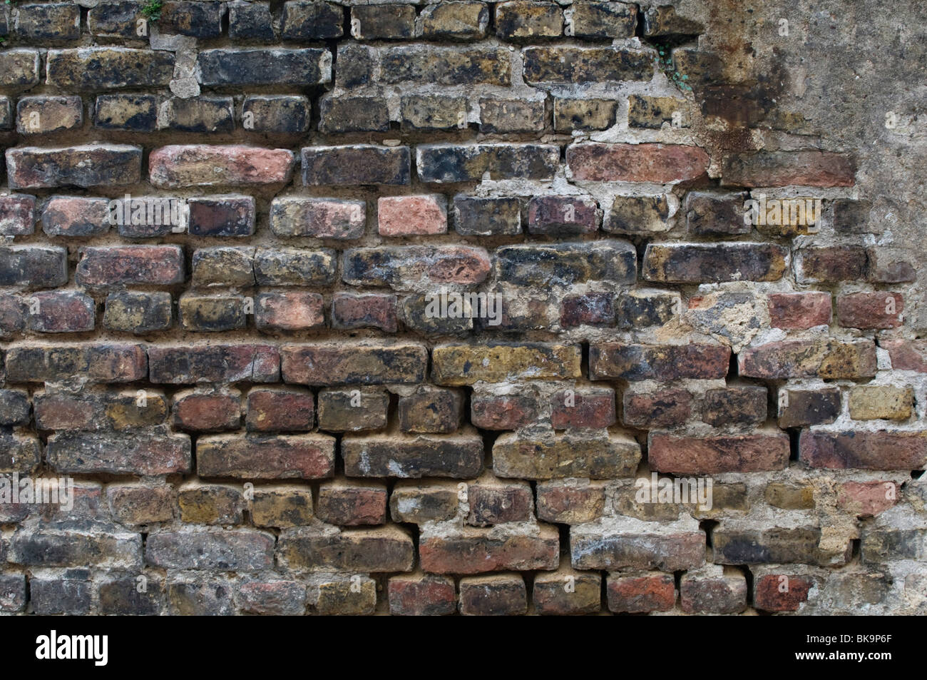 Old brick wall, with limescale runmarks, background - Stock Image