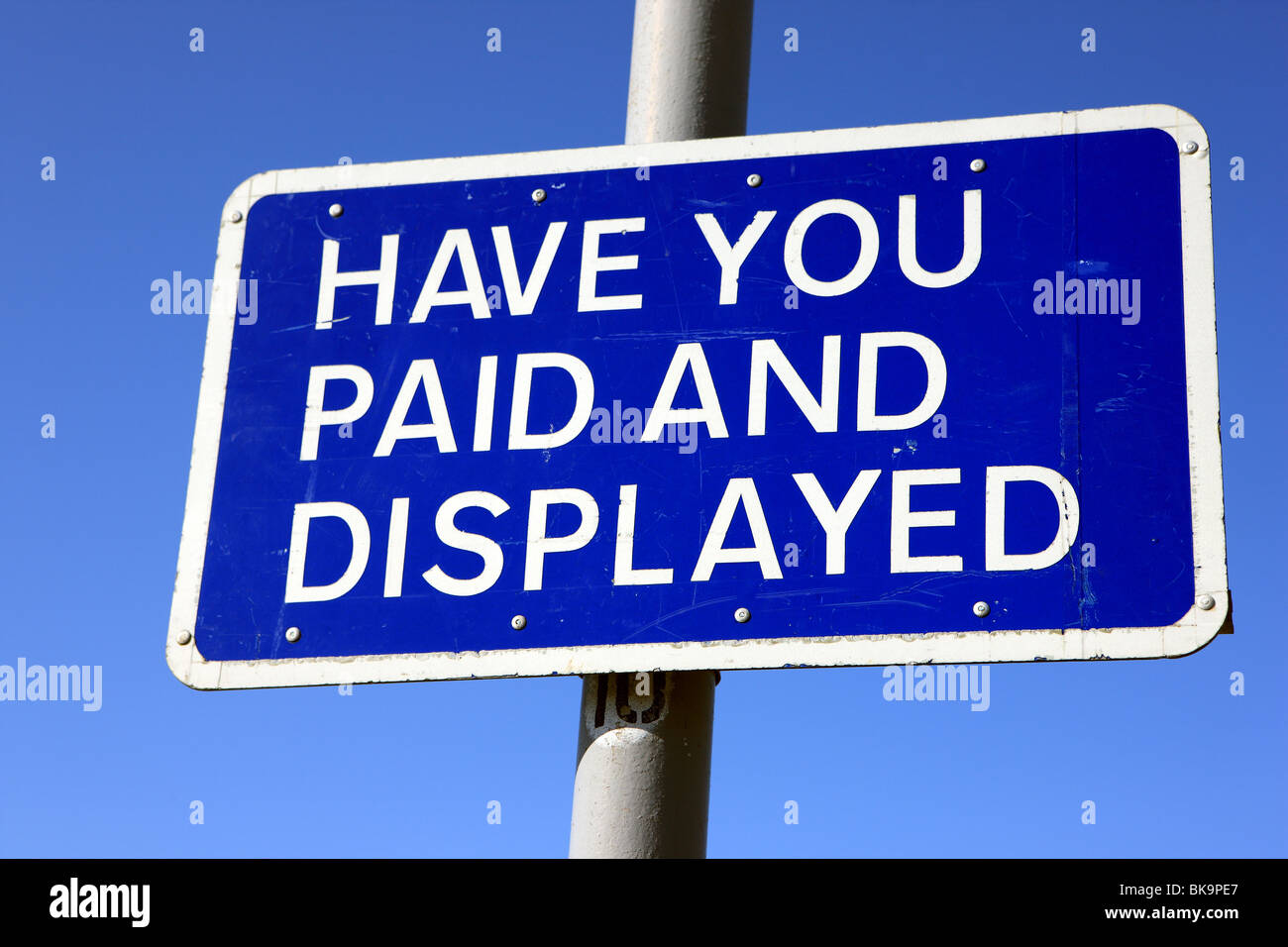 Sign at a car park asking 'Have you paid and Displayed' referring to the purchase and displaying of a car - Stock Image