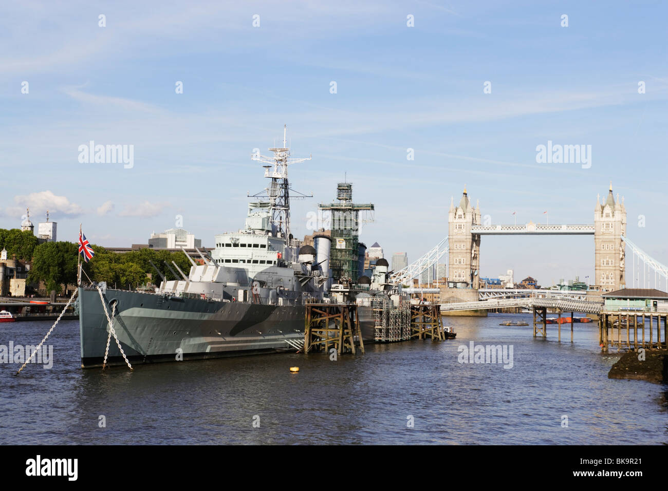 HMS Belfast on river Thames with Tower Bridge in background, London, London, England, United Kingdom - Stock Image