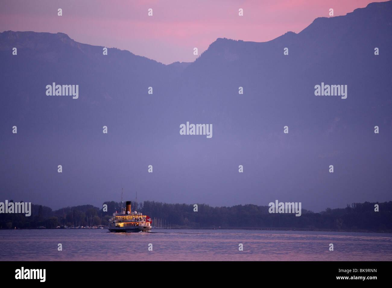 Excursion boat on Lake Geneva arriving Chillon Castle, Veytaux, Vaud, Switzerland Stock Photo