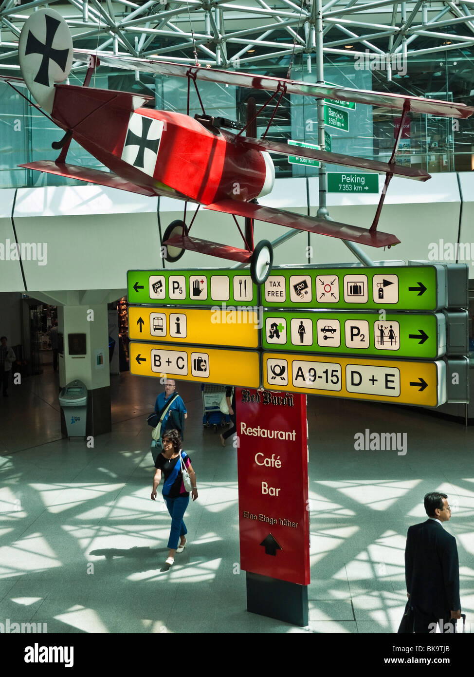 Sign for the Red Baron Restaurant Cafe Bar and suspended replica of the Red Baron's airoplane at Tegel Airport, - Stock Image