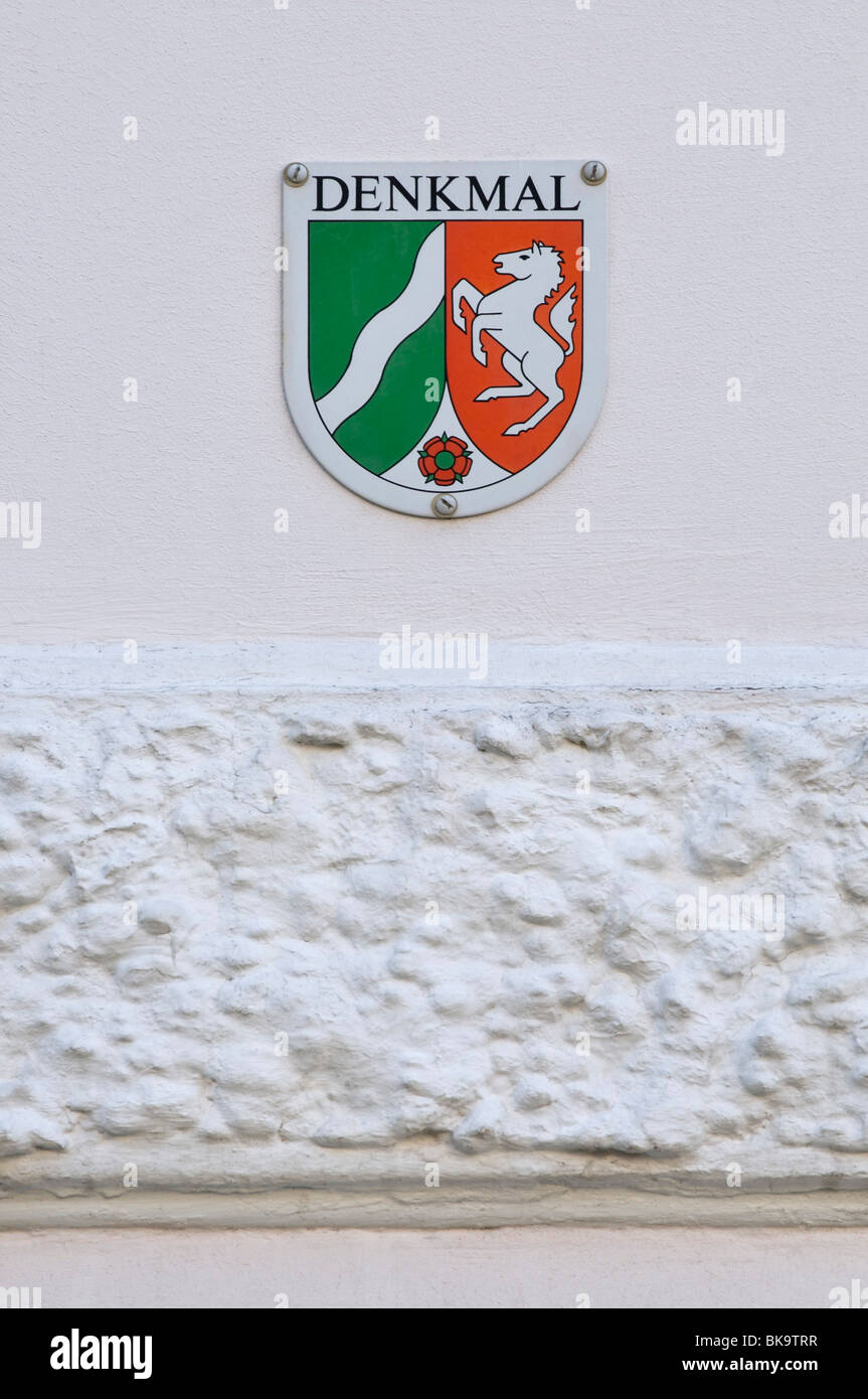 Monument preservation plaque on house wall with stucco, North Rhine-Westphalia, Germany - Stock Image