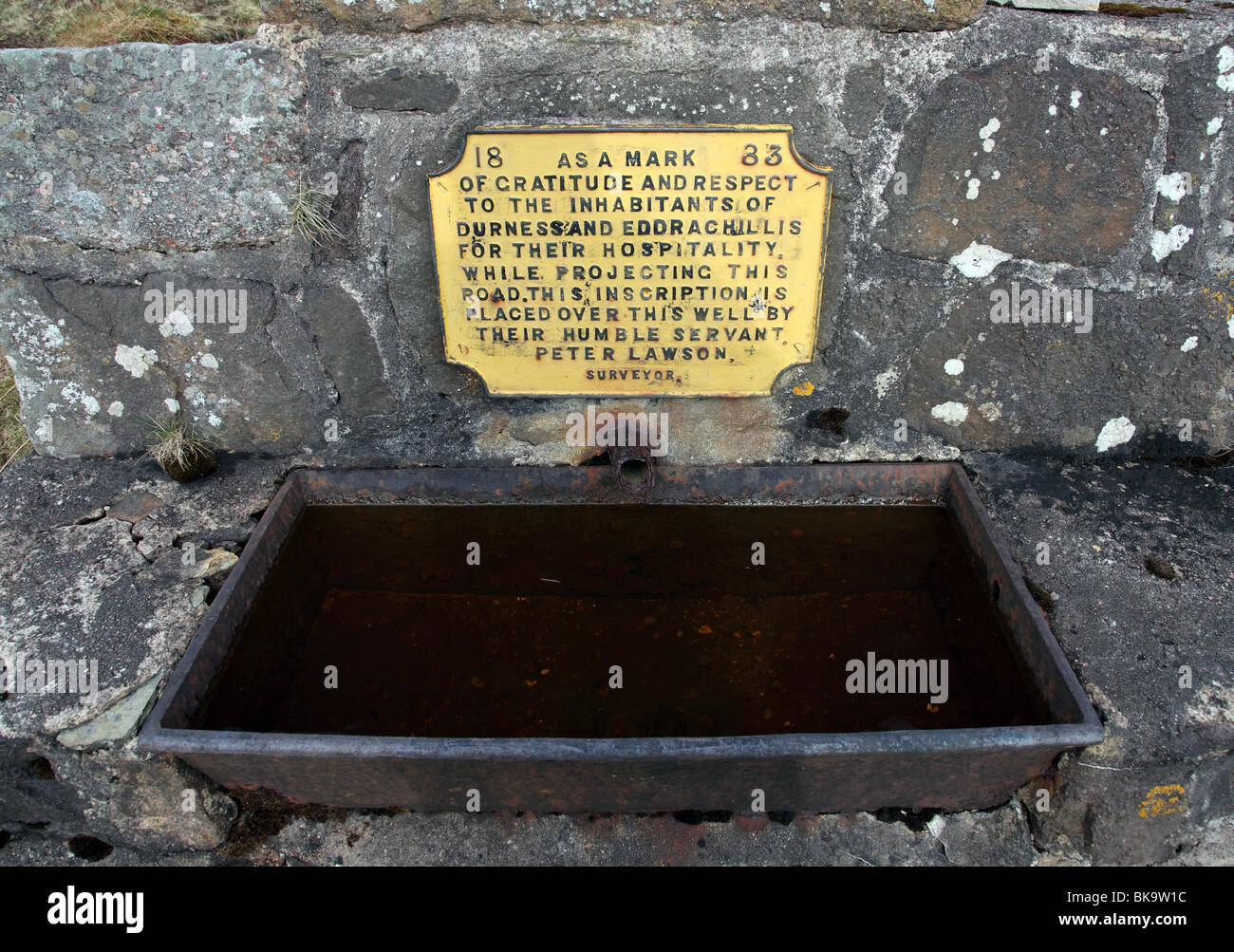 Inscription on Well Dedicated to the People of Durness and Edrachill by Surveyor Peter Lawson Durness Sutherland - Stock Image