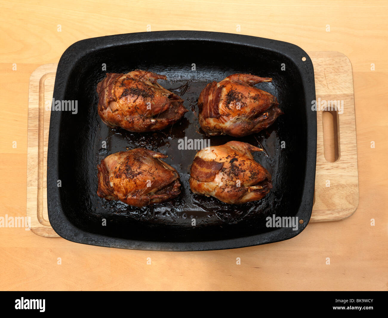 Four Cooked Partridges on a Baking Dish England - Stock Image