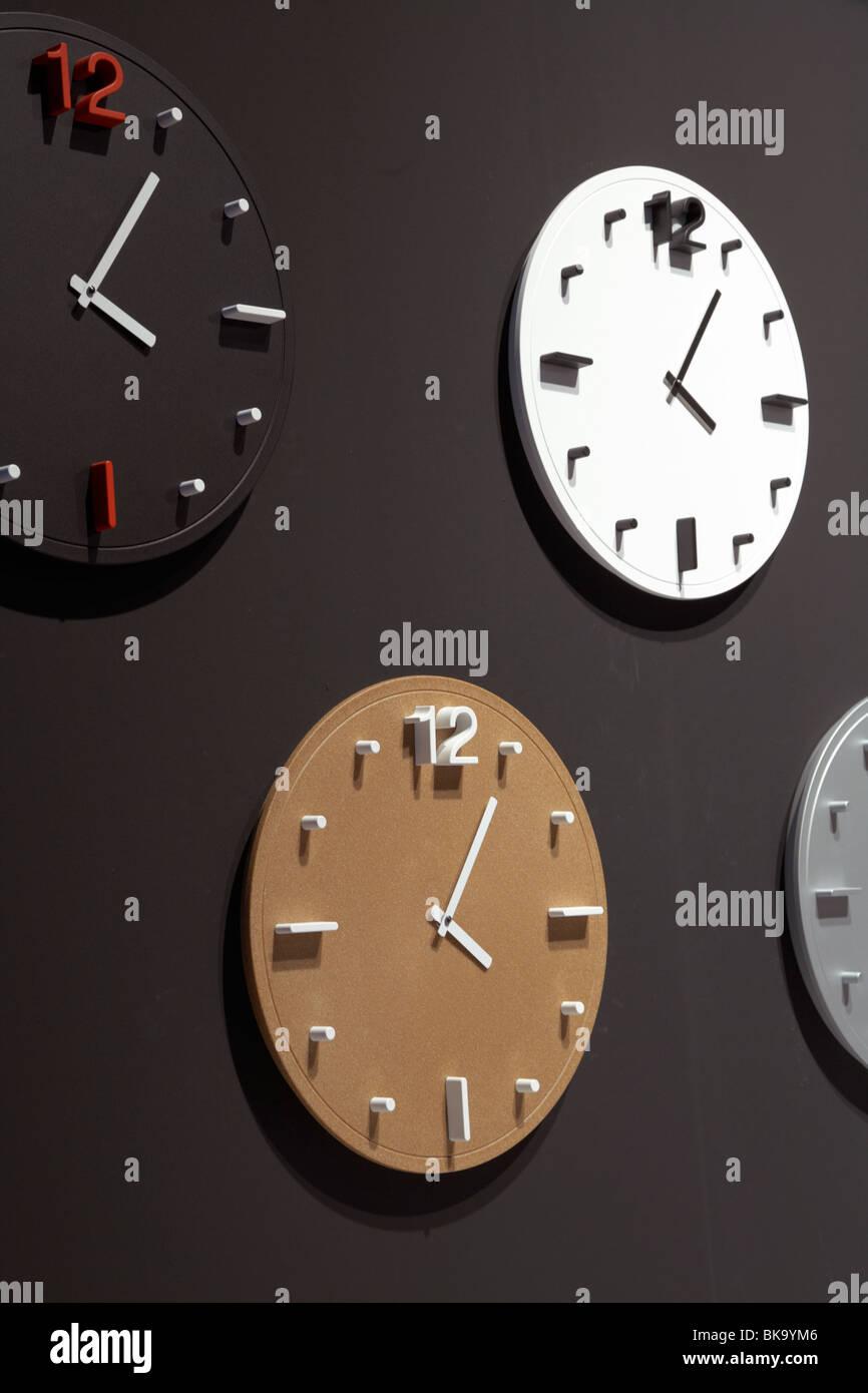 Contemporaneous wall clocks - Stock Image