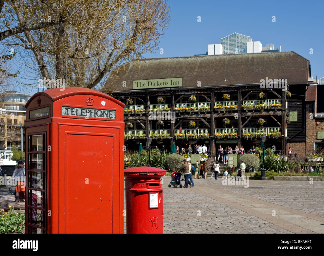 A traditional red telephone box and a cast iron red letter box near the Dickens Inn pub in London.  .  Photo by - Stock Image
