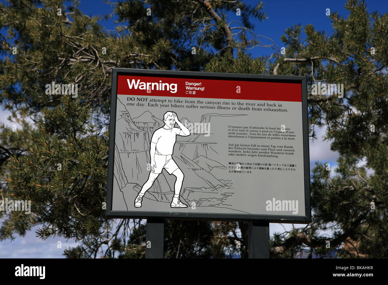 Warning sign for hikers in the Grand Canyon National Park stating the dangers of walking in this area Stock Photo