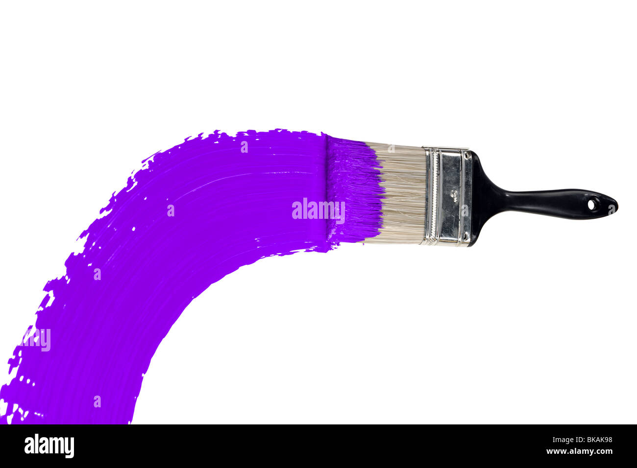 Brush with purple paint isolated over white background - Stock Image