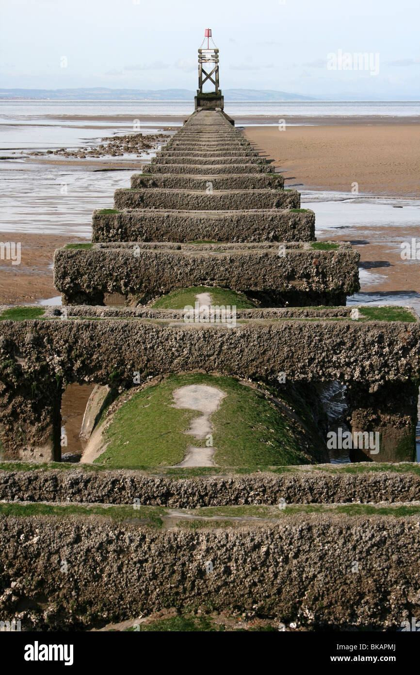 Sewer Outflow Pipe Running Into the Sea At Waterloo, Merseyside, UK - Stock Image