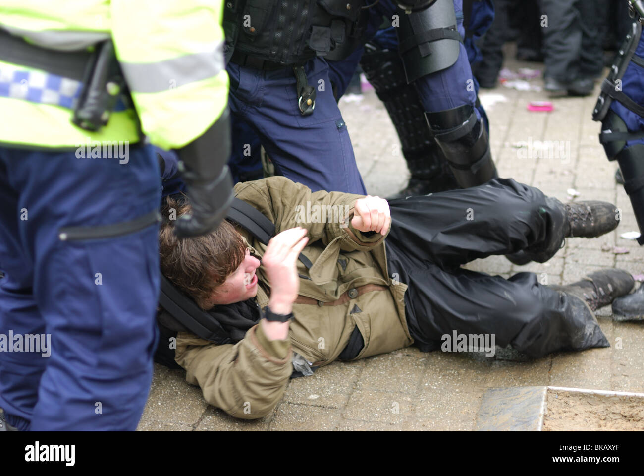 A Unite Against Fascism protester in Bolton rallying against the EDL is arrested by riot police in a brutal manner. - Stock Image