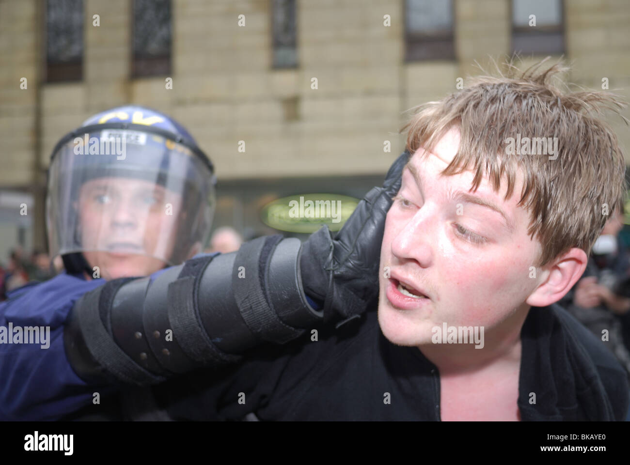 A Unite Against Fascism supporter is arrested by riot police at an English Defence League rally in Bolton. - Stock Image