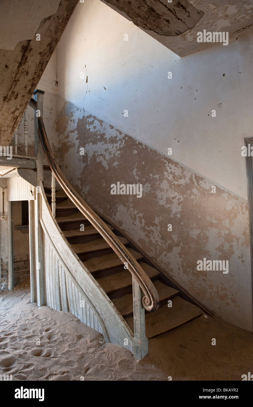 Old Staircase in the Architekt or Architects House, Kolmanskop Ghost Town near Luderitz, Namibia - Stock Image