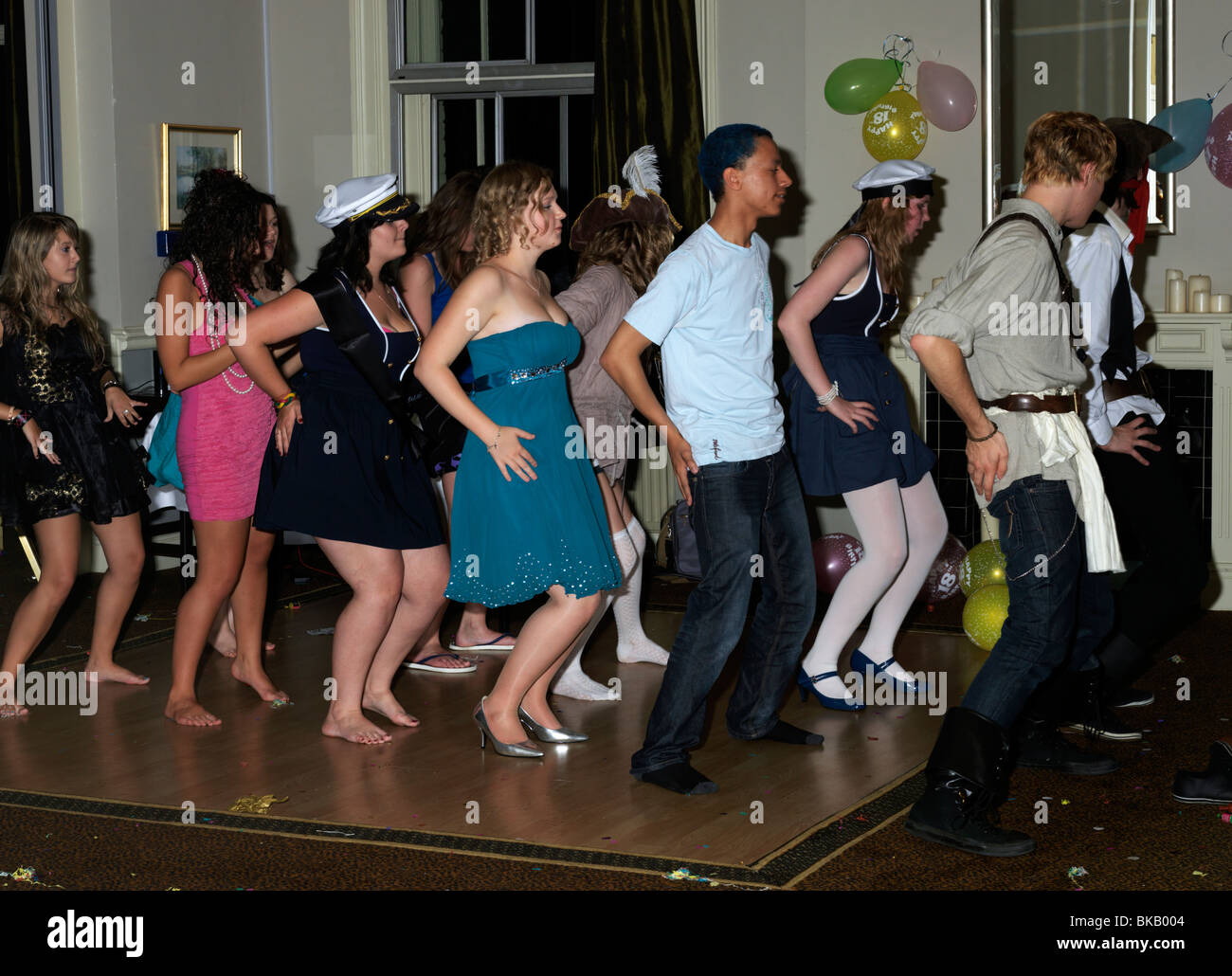 Eighteenth Birthday Party Teenagers In Fancy Dress Pirates And Sailors Dancing - Stock Image