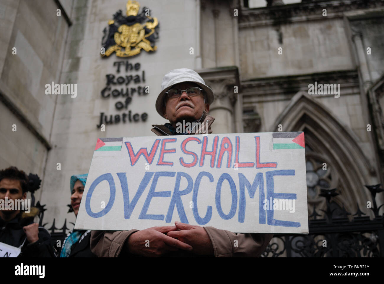 A member of the Palestinian Solidarity Campaign demonstrates outside the Royal Courts of Justice in the Strand. - Stock Image