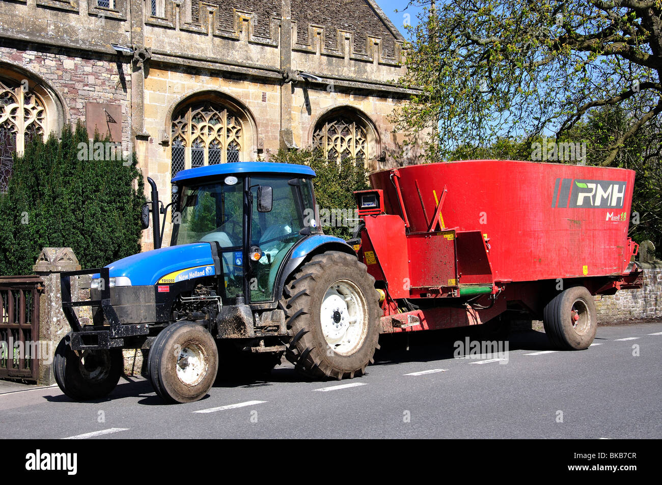 New Holland Tractor and RMH Mixell 18 Feeder Mixer