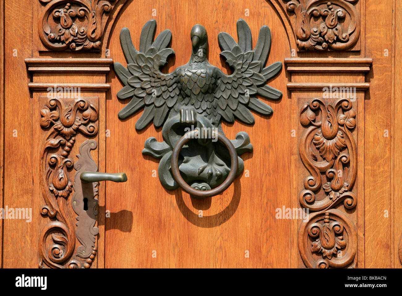 Eagle-shaped knocker of a hand carved door of a mannerist house at the Long Market in Gdansk Poland & Eagle-shaped knocker of a hand carved door of a mannerist house at ...