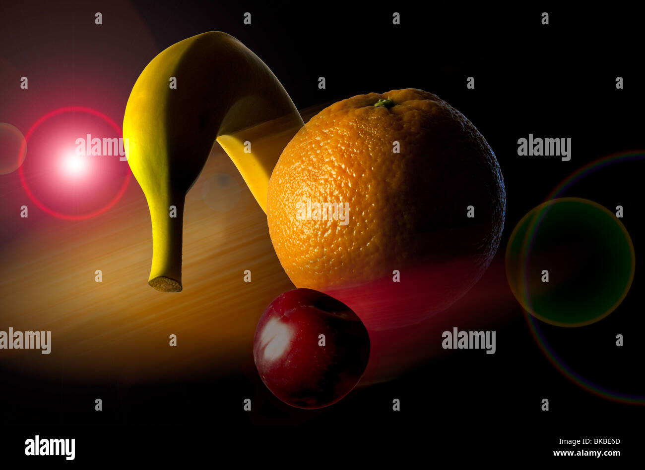 Fruit selection floating through space. Banana, orange and a plum collage set in outer space background. Abstract - Stock Image