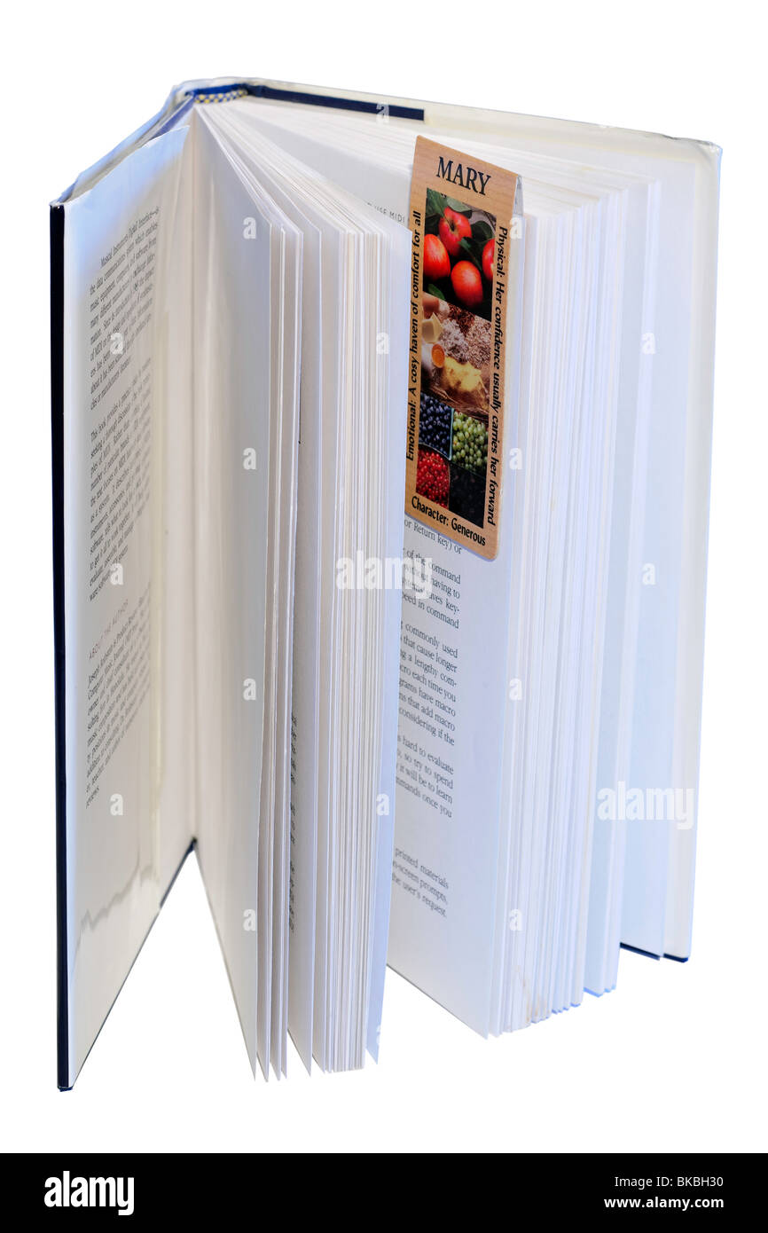 Open book with magnetic bookmark attached - Stock Image