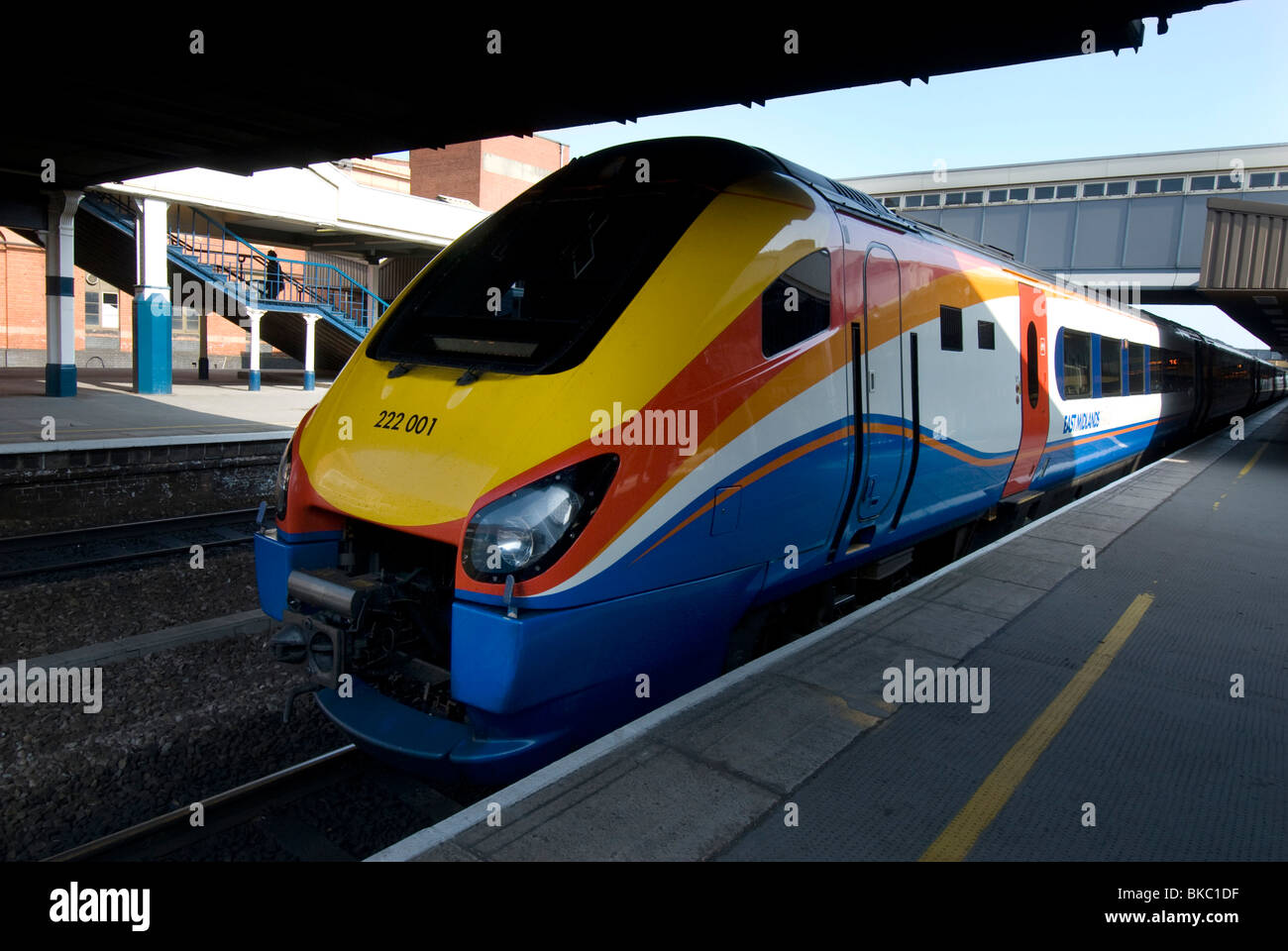 An East Midlands Class 222 diesel train in 2010 livery of yellow, orange, white and blue. - Stock Image