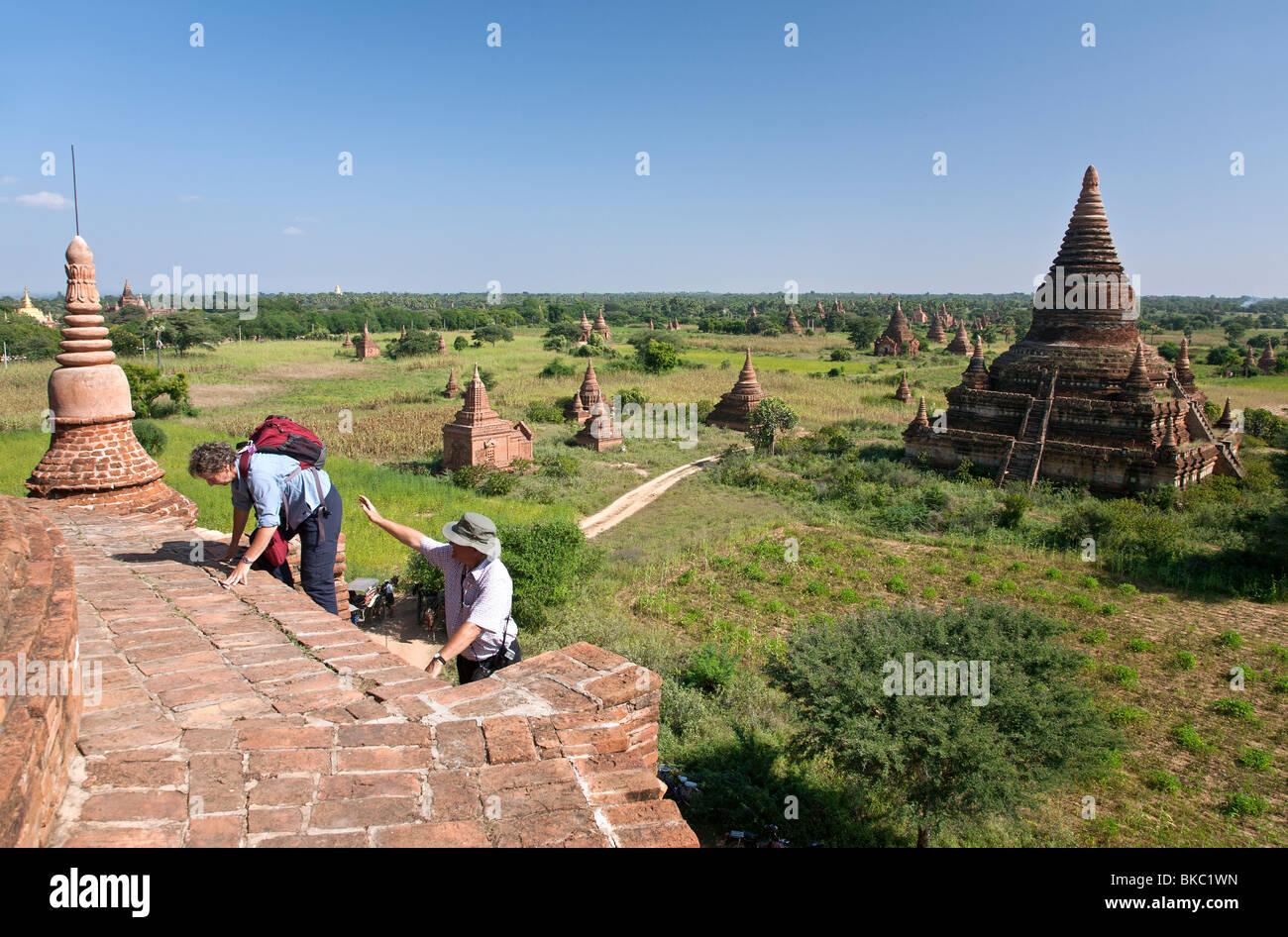 Tourists climbing to the top of a temple. Buledi Group. Bagan. Myanmar Stock Photo