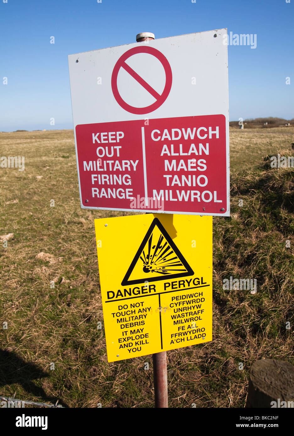 Warning sign for military firing range MOD Castlemartin range on coastal footpath Pembrokeshire Wales UK - Stock Image
