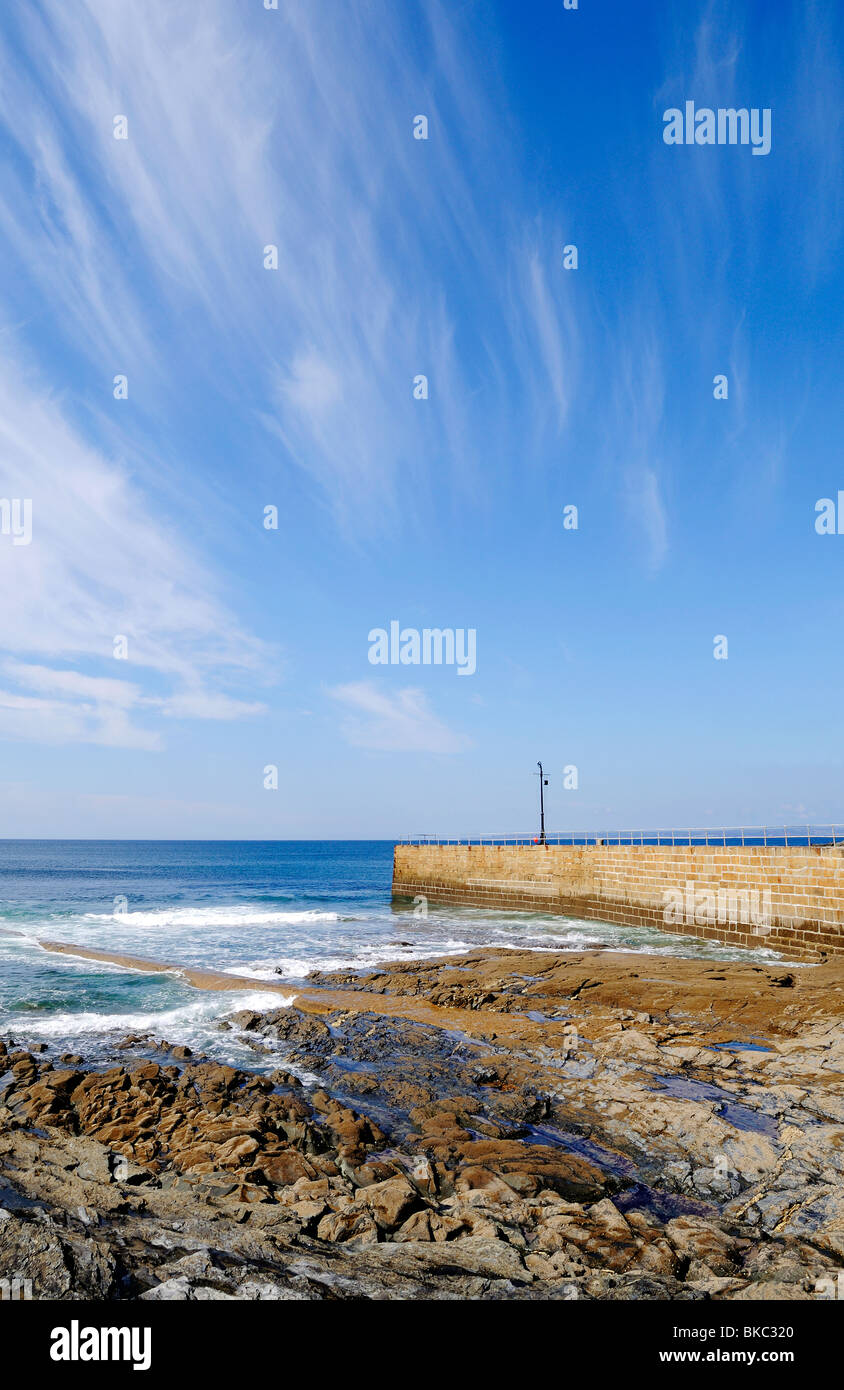 cirrus clouds over the ocean at porthleven in cornwall, uk - Stock Image