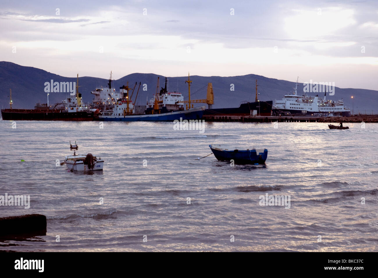 Albania's Vlora port at nightfall: its bay is where the Ionian and Adriatic seas meet - Stock Image
