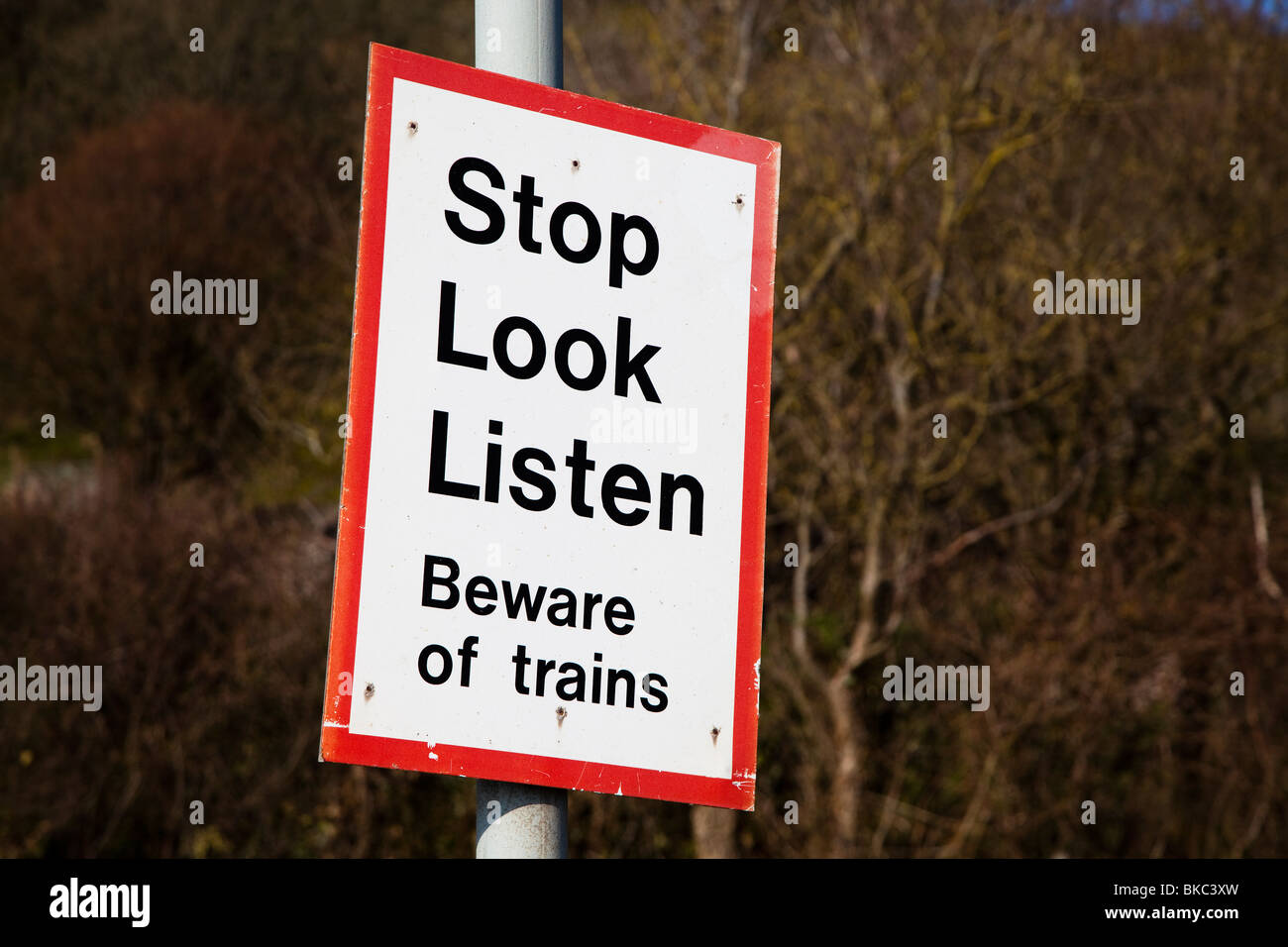 Stop Look Listen Beware of Trains warning sign on railway line St Ishmaels Pembrokeshire Wales UK - Stock Image