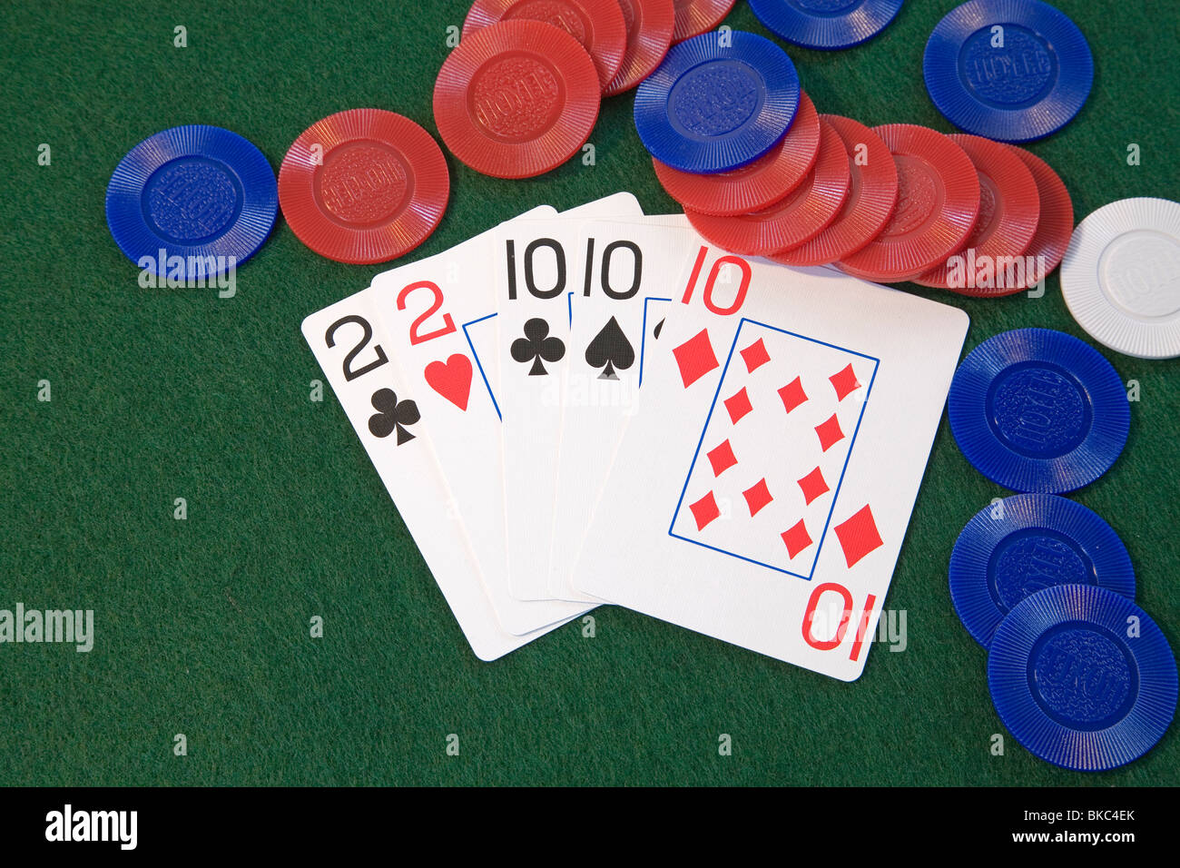 A 'full house' poker hand, deuces and tens, in five card draw or stud poker - Stock Image