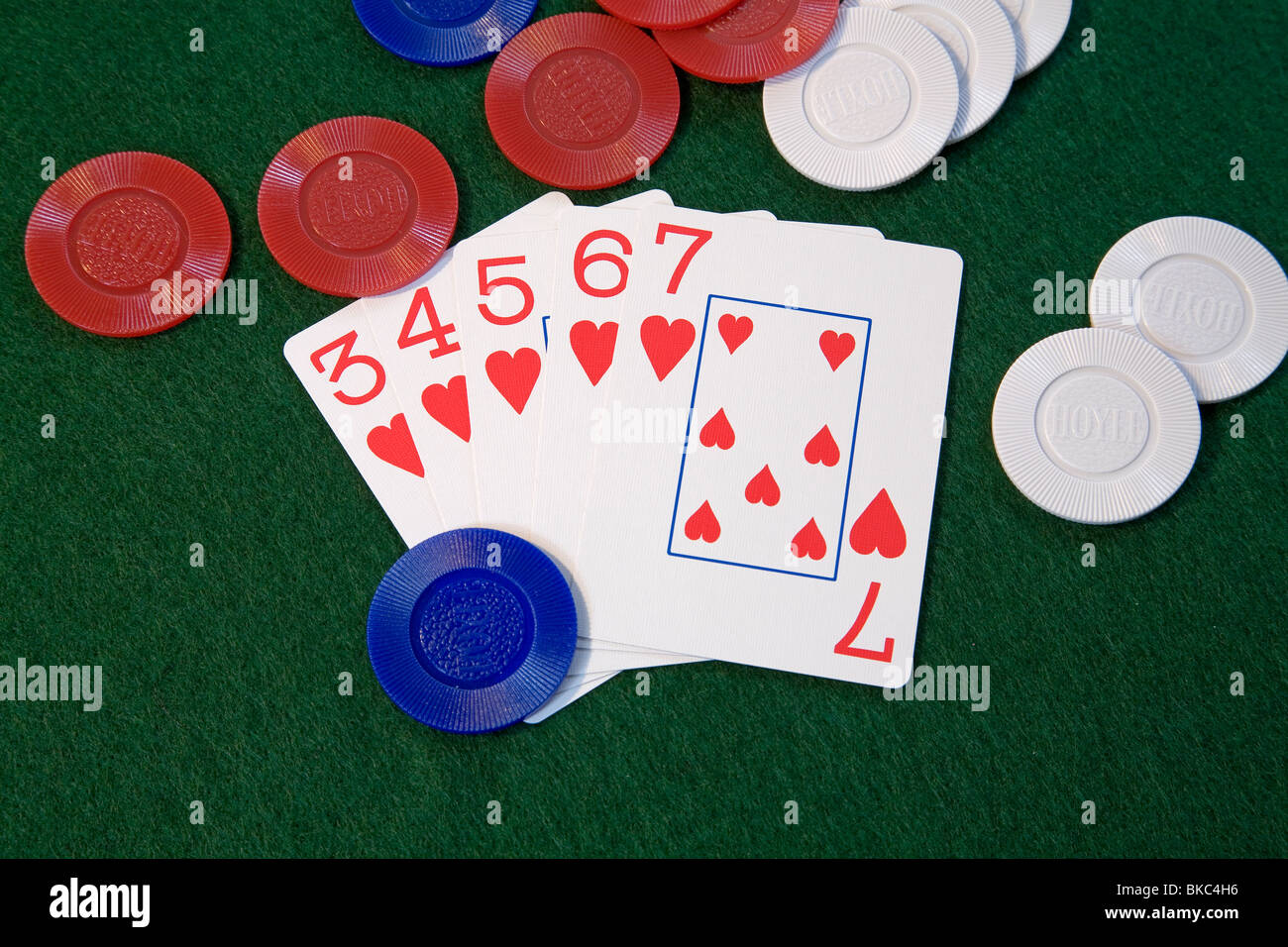 A 'straight flush' poker hand, of hearts, in five card draw or stud poker - Stock Image