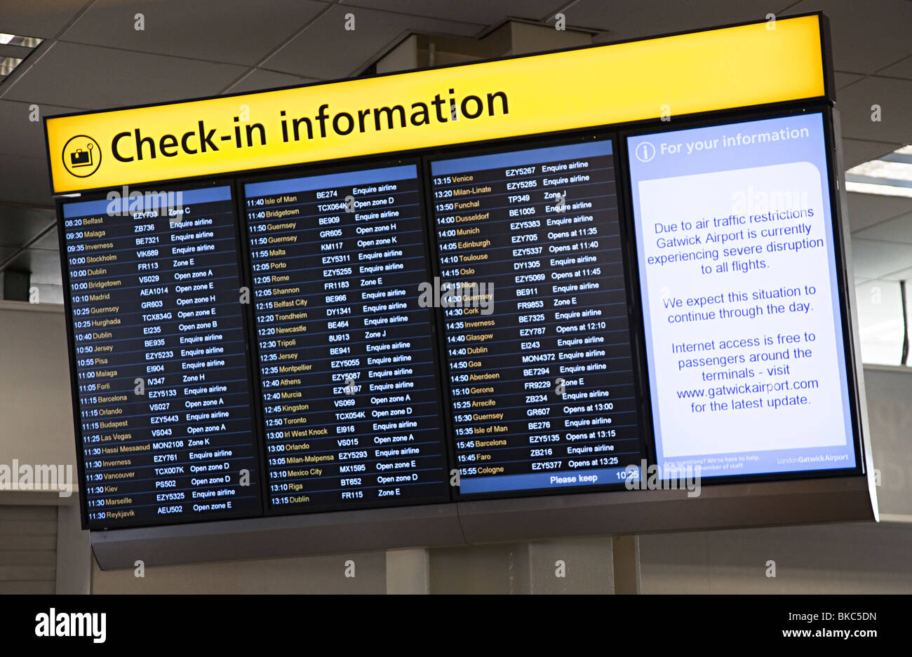 Check in information board with cancelled flight information at Gatwick  airport London England UK