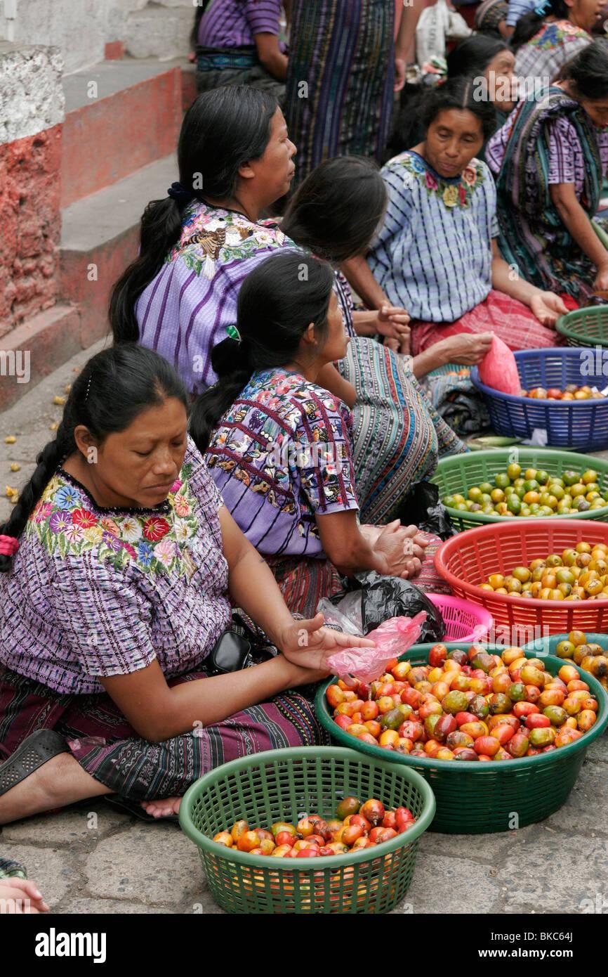 Tzutuhil Maya women dressed in traditional clothes on the market in Santiago Atitlan, Lake Atitlan, Guatemala, Central - Stock Image
