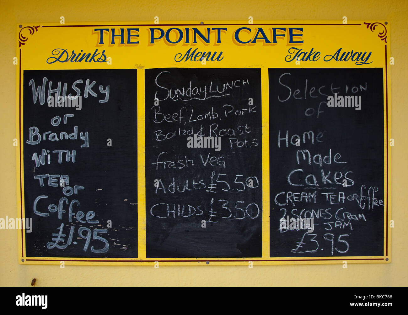 Chalkboard menu prices for drinks and food the Point Cafe Pendine Wales UK - Stock Image