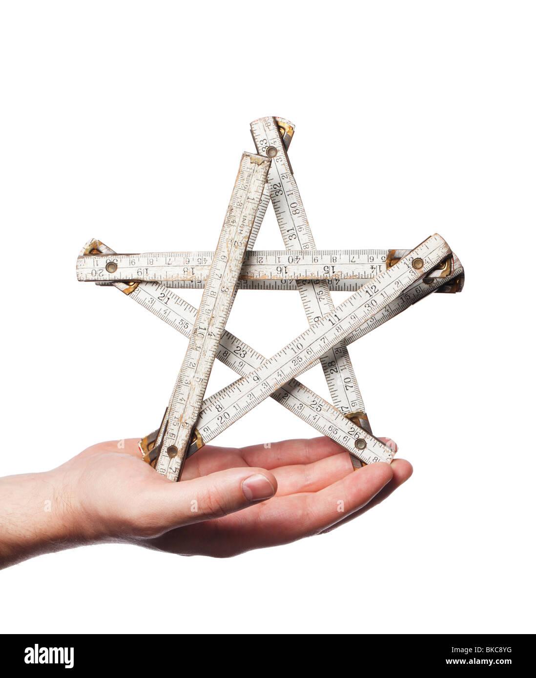 Folding carpenter ruler as a star - Stock Image