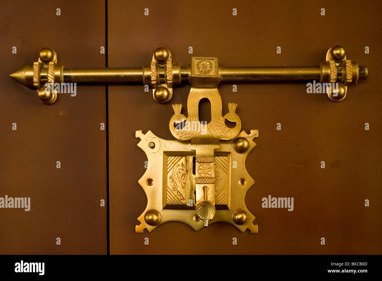 Antique traditional brass door latch and lock on wooden doors common in  kerala india locally known as manichithrathazhu - Antique Traditional Brass Door Latch And Lock On Wooden Doors Common