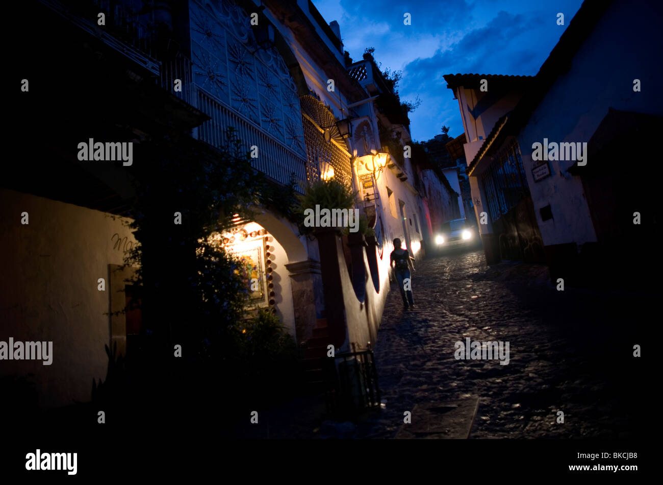 A woman walks in a street of Taxco de Alarcon in Guerrero State, Mexico, August 20, 2007. Photo/Chico Sanchez Stock Photo