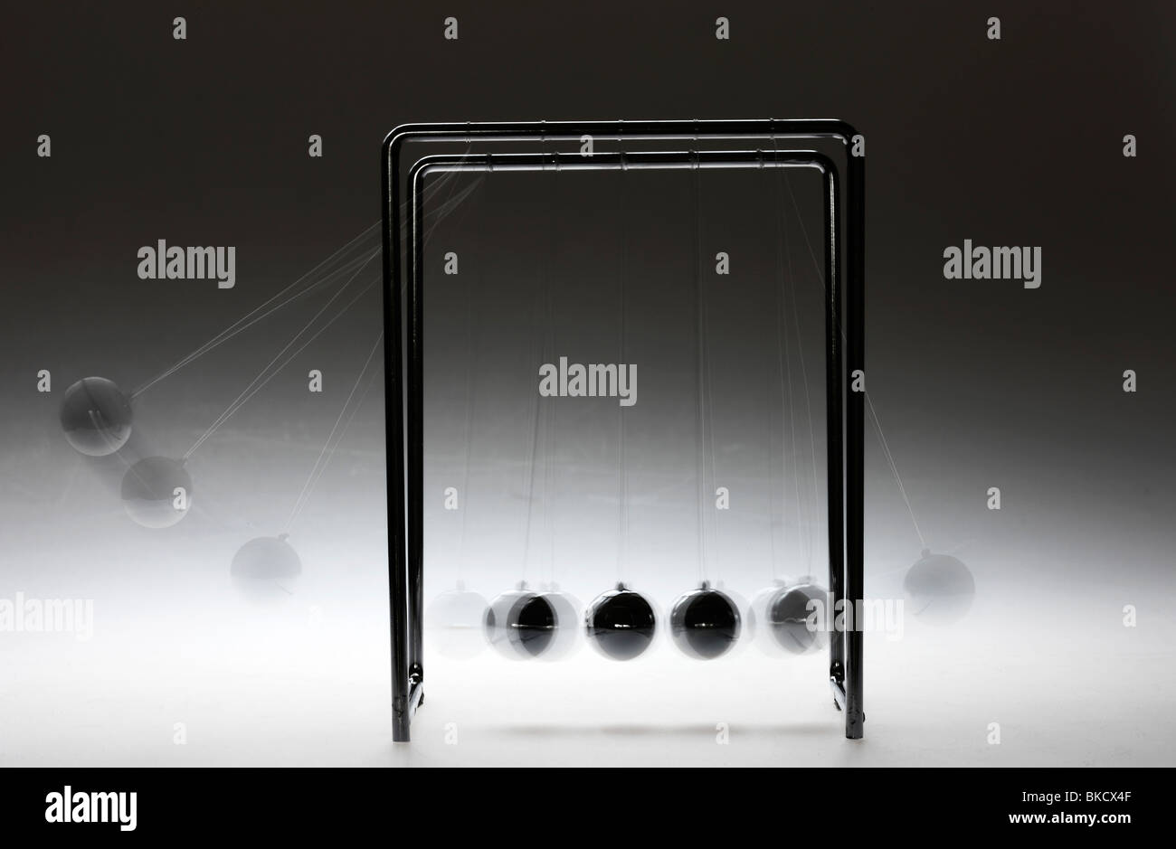 Pendulum, chrome balls, toy, gives impulses. Newton pendulum. Stock Photo