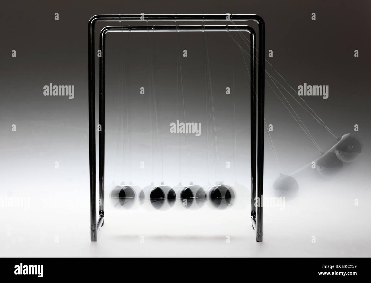 Pendulum, chrome balls, toy, gives impulses. Newton pendulum. - Stock Image