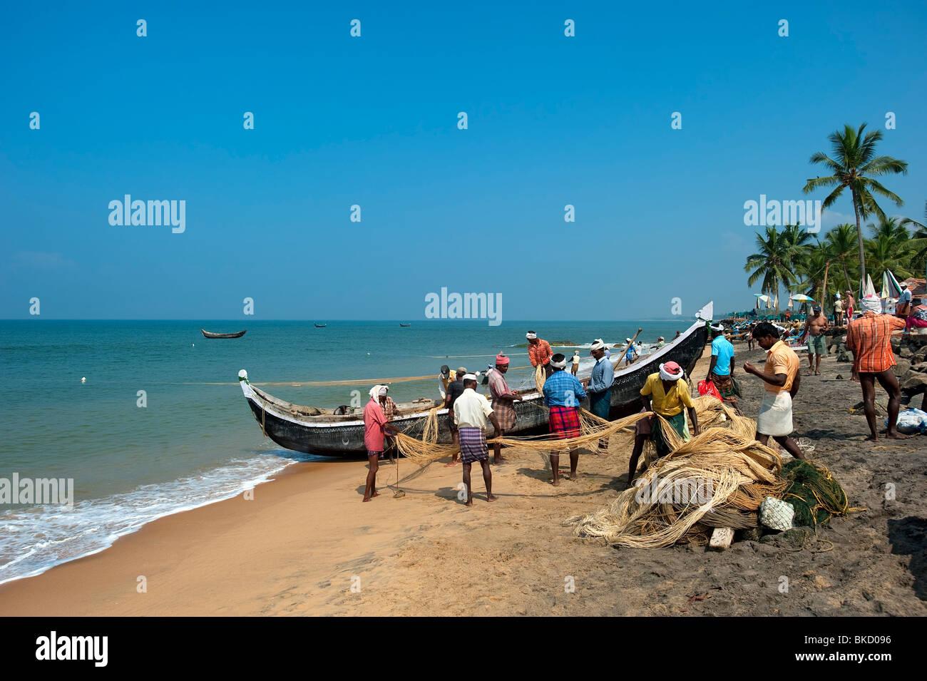 Samudra Beach with Fishermen, Kovalam, Kerala, India - Stock Image