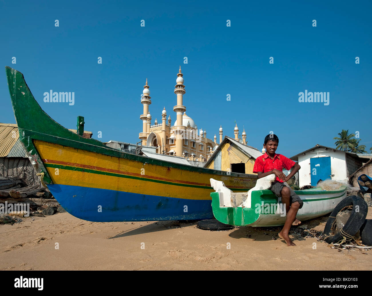 Mosque on Vizhinjam Fishing Harbour Beach, Kerala, India - Stock Image