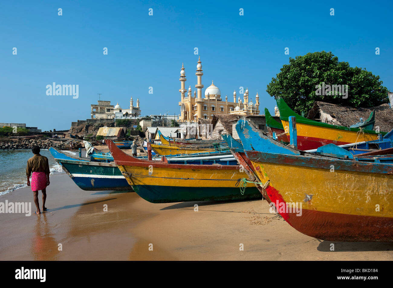 Mosque and Fishing Boats on Vizhinjam Fishing Harbour Beach, Kerala, India - Stock Image