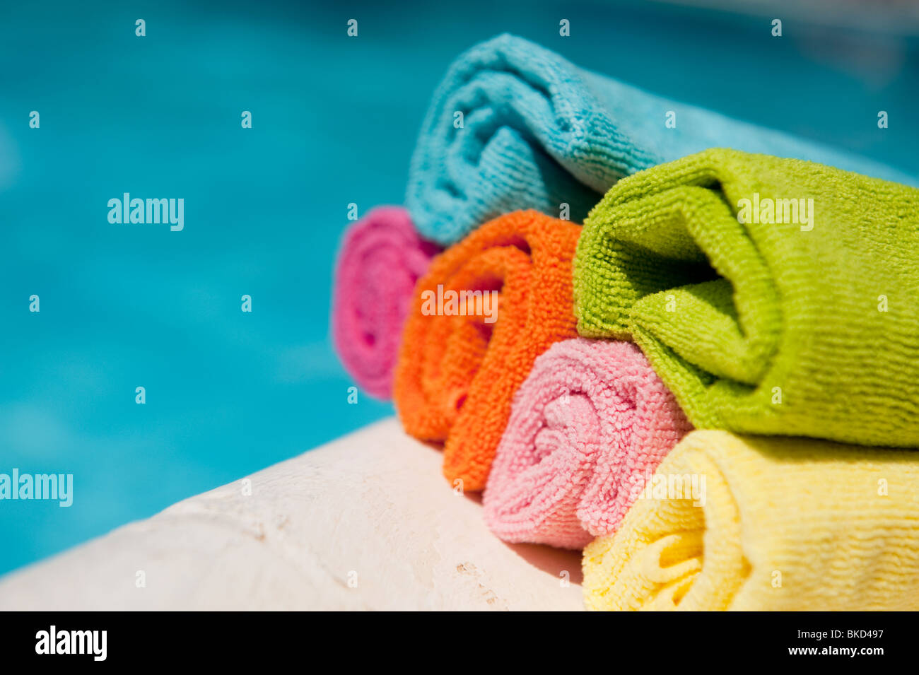 swimming,pool,colorful,rolled,towels, - Stock Image