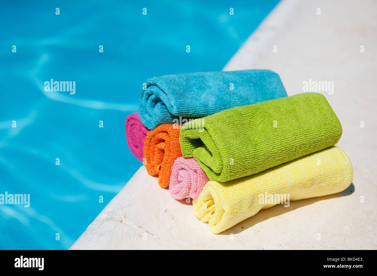 colorful rolled towels near the swimming pool Stock Photo ...
